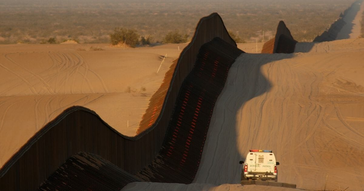 A border patrol vehicle drags the sand to make any new footprints of border crossers more visible along a recently constructed section of the controversial U.S.-Mexico border fence expansion on previously pristine desert sands on March 14, 2009, between Yuma, Arizona, and Calexico, California.