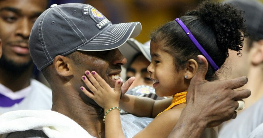 Kobe Bryant celebrates with his daughter Gianna following the Los Angeles Lakers' 99-86 defeat of the Orlando Magic in Game 5 of the NBA Finals at Amway Arena in Orlando, Florida, on June 14, 2009.