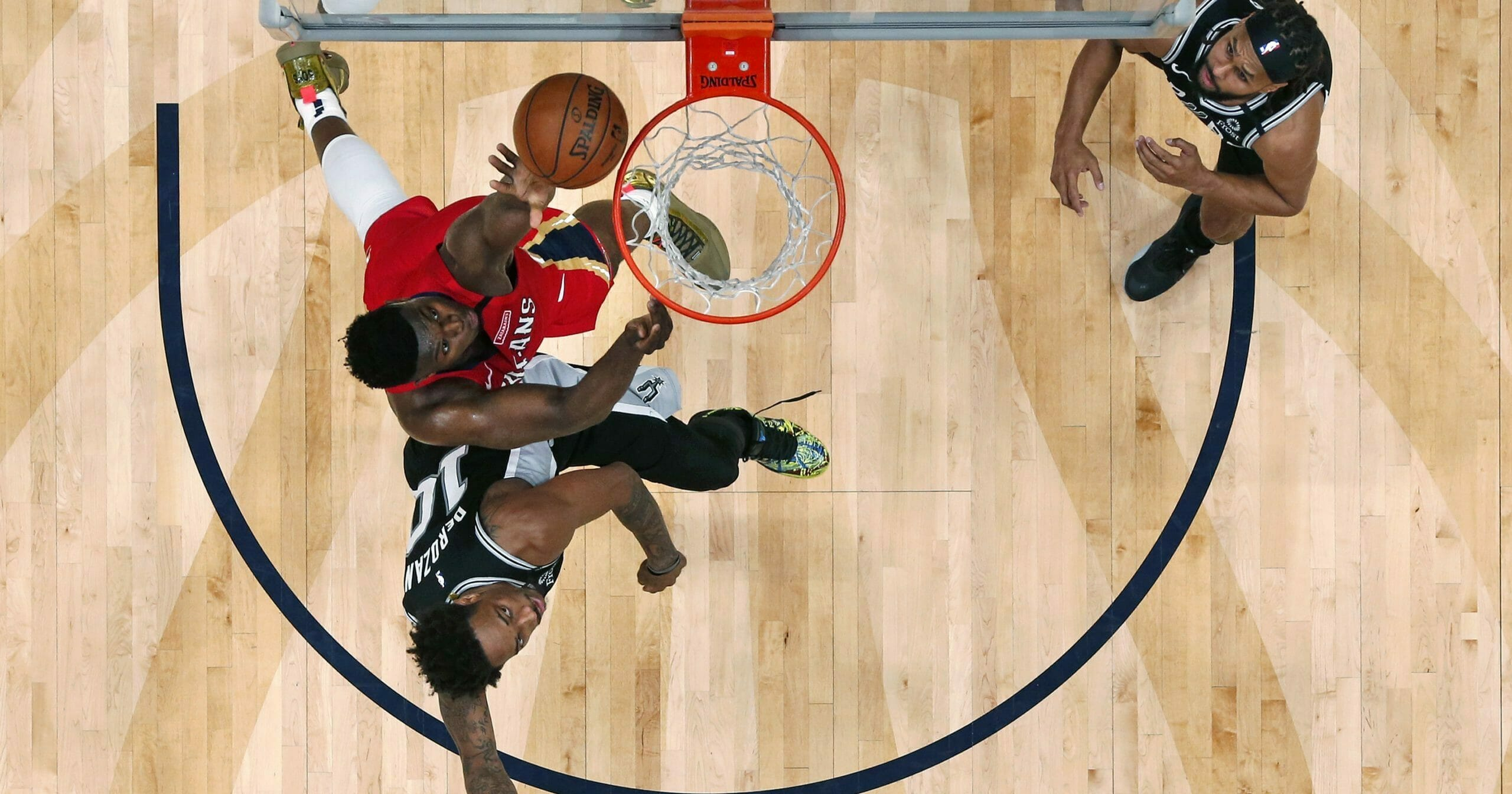 New Orleans Pelicans forward Zion Williamson goes to the basket against San Antonio Spurs forward DeMar DeRozan (10) in the second half of an NBA basketball game in New Orleans on Jan. 22, 2020.