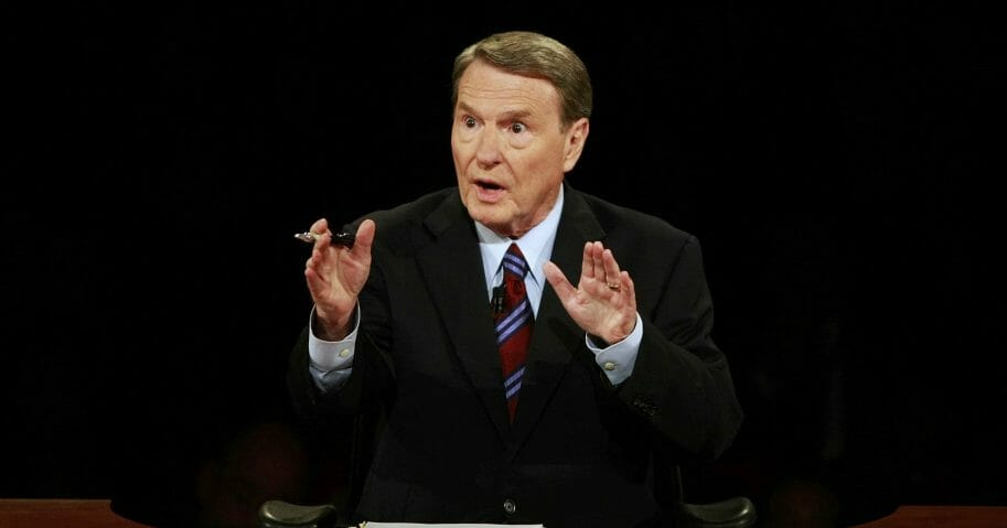 This Sept. 26, 2008, file photo shows debate moderator Jim Lehrer during the first U.S. presidential debate between presidential nominees then-Sen. John McCain (R-Arizona), and then-Sen. Barack Obama (D-Illinois) at the University of Mississippi in Oxford, Mississippi. PBS announced that PBS NewsHour's Jim Lehrer died Jan. 23, 2020, at home. He was 85.