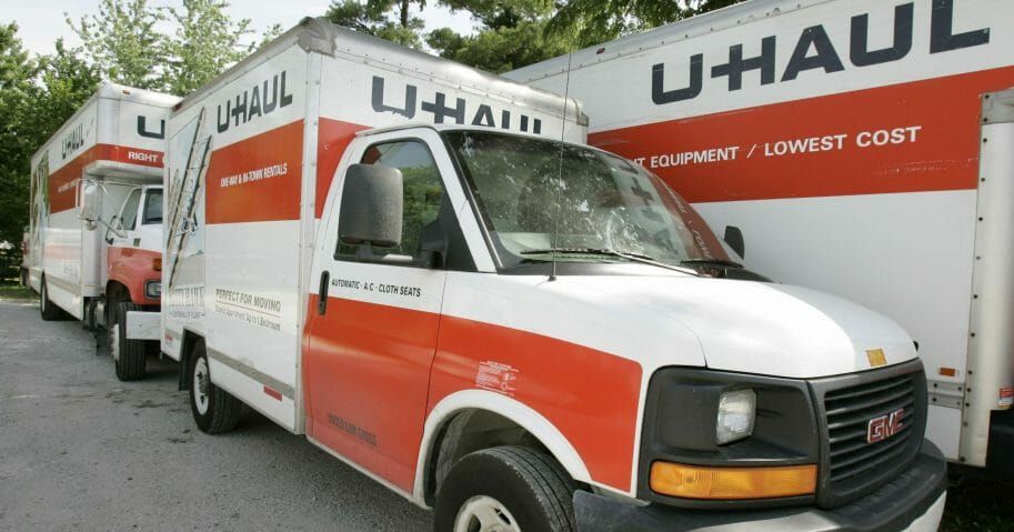 """In this June 14, 2006, file photo, U-Haul trucks sit on a dealer lot in Des Moines, Iowa. U-Haul has a New Year's resolution: cut down on hiring people who smoke. The moving company said that it won't hire nicotine users in the 21 states where it is legal to do so, saying that it wants to ensure a """"healthier workforce."""" The new policy will start Feb. 1, 2020, and won't apply to those hired before then."""