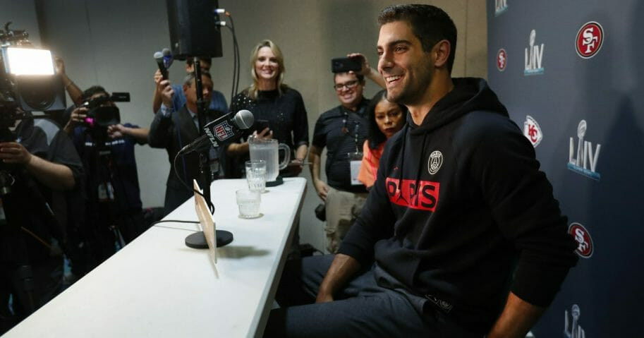 San Francisco 49ers quarterback Jimmy Garoppolo smiles as he speaks during a media availability for the NFL Super Bowl LIV football game on Jan. 28, 2020, in Miami.