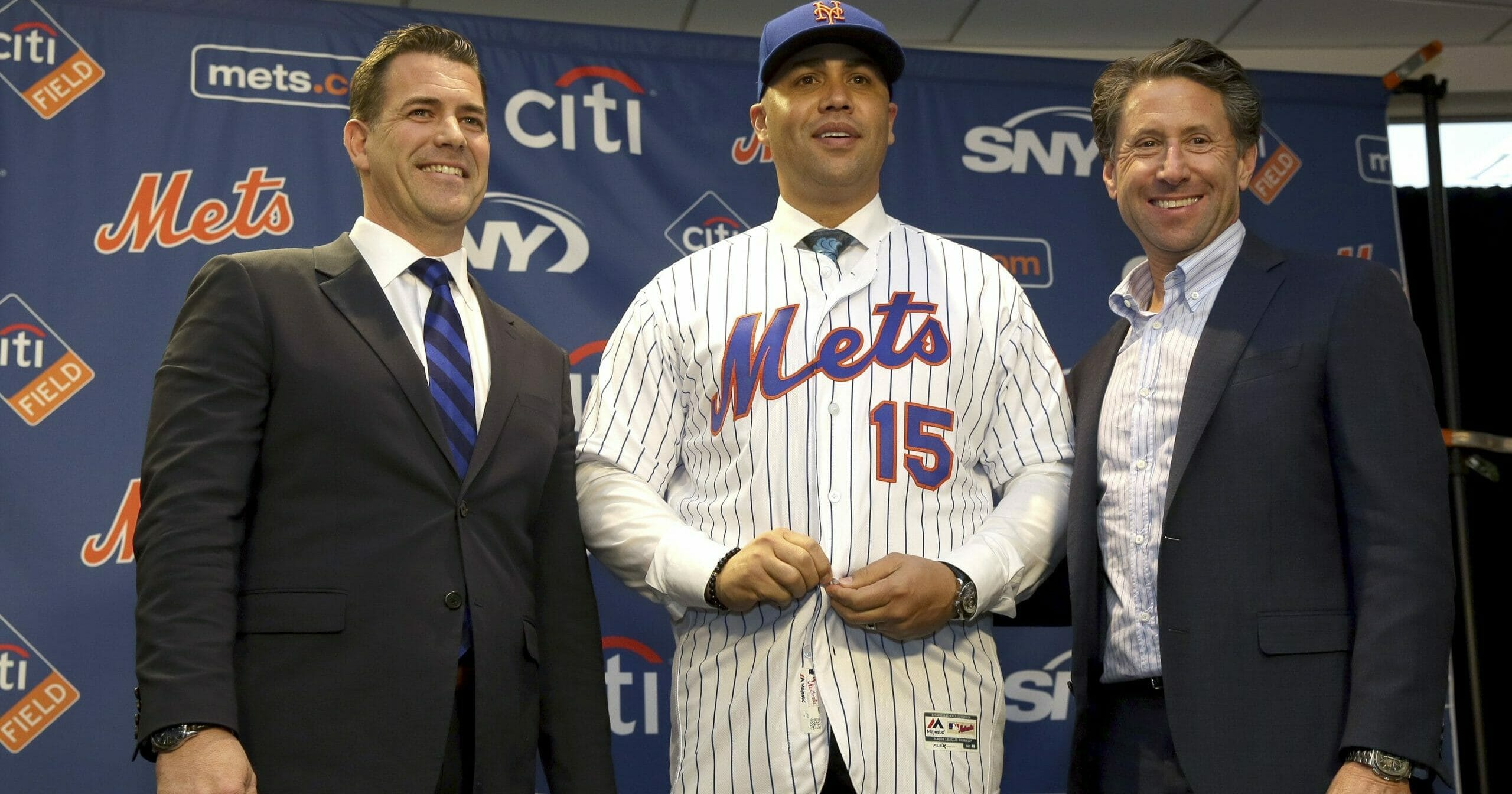 In this Nov. 4, 2019, file photo, then-New York Mets manager Carlos Beltran, center, poses for a picture with general manager Brodie Van Wagenen, left, and Mets COO Jeff Wilpon during a news conference at Citi Field in New York. Beltran is out as manager of the Mets. The team announced the move Jan. 16, 2020.