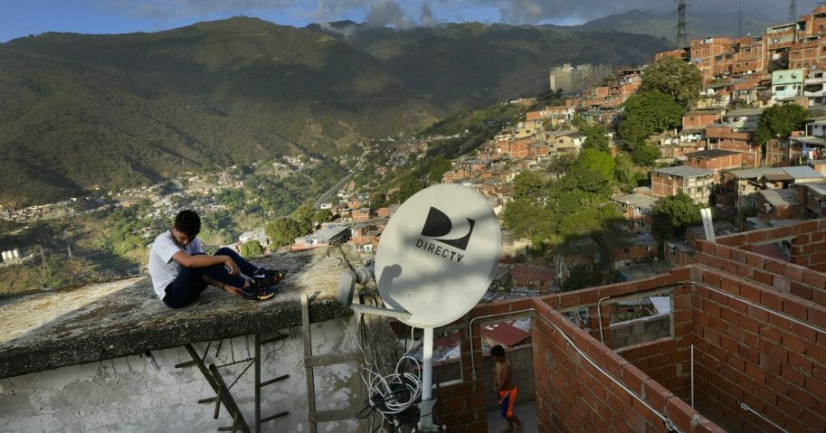 A DirectTV dish stands on home in the Catia neighborhood of Caracas, Venezuela, on Jan. 9, 2020.