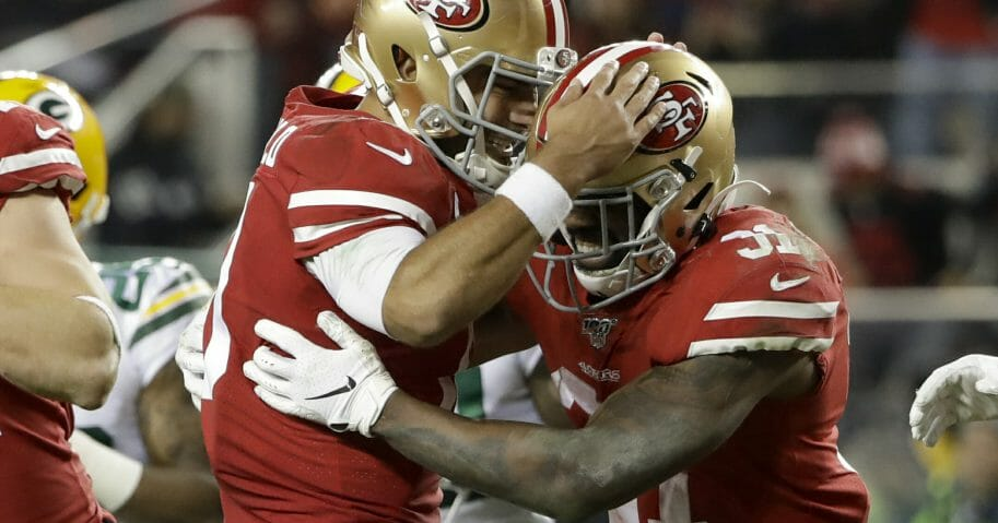 San Francisco 49ers running back Raheem Mostert, right, celebrates his touchdown with quarterback Jimmy Garoppolo during the NFC championship game against the Green Bay Packers on, Jan. 19, 2020, in Santa Clara, California.