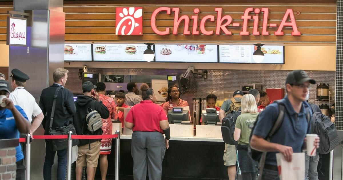 People stand in line for Chick-fil-A at the Hartsfield-Jackson Atlanta International Airport on Aug. 8, 2019.