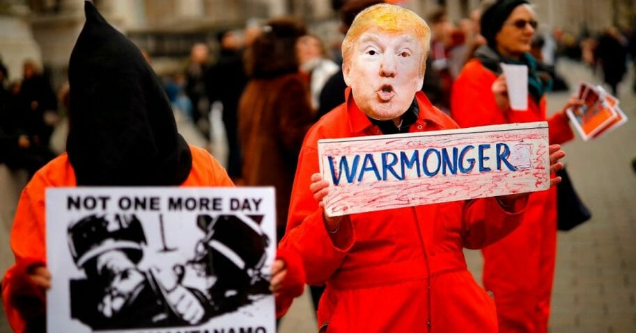 A protester holds up a placard, dressed as President Donald Trump during a demonstration against the threat of war on Iran, in central London on Jan. 11, 2020.