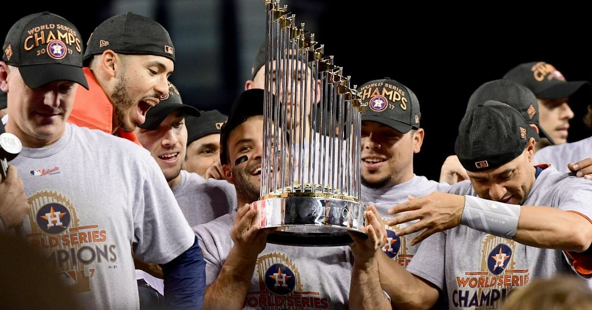 The Houston Astros hold the Commissioner's Trophy after winning the 2017 World Series at Dodger Stadium in Los Angeles.