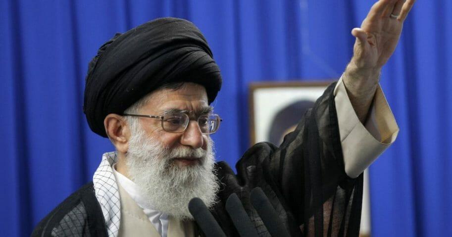 Iranian Supreme Leader Ayatollah Ali Khamenei gestures as he addresses the faithful at the weekly Muslim Friday prayers at Tehran University on June 19, 2009.