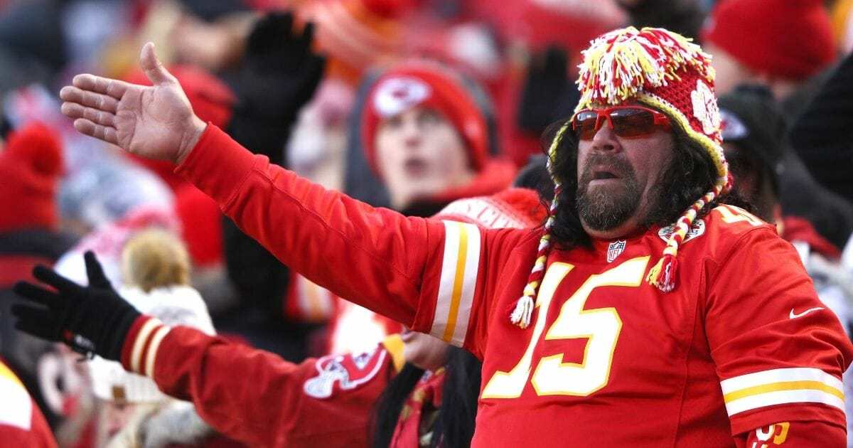"""Kansas City Chiefs fans do the """"tomahawk chop"""" during the AFC championship game at Arrowhead Stadium on Jan. 19, 2020."""