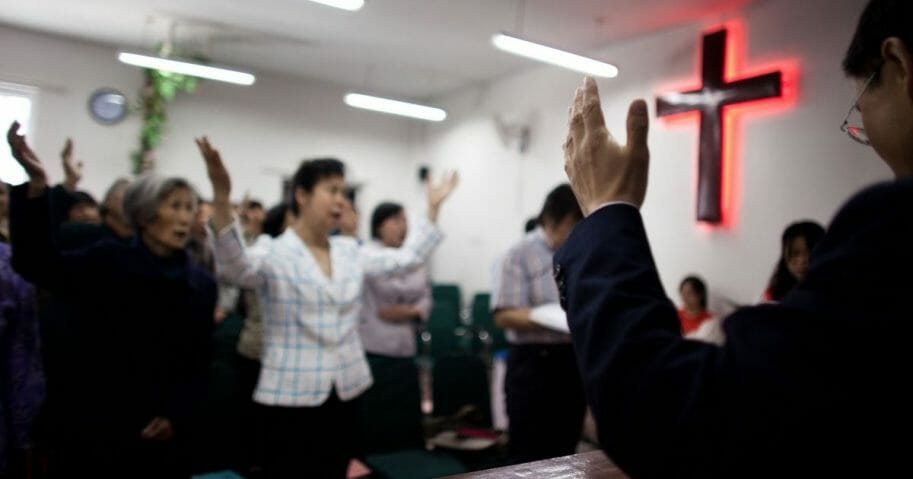 Members of the house church Xin Mingling meet for Sunday service May 15, 2011, in Beijing, China.