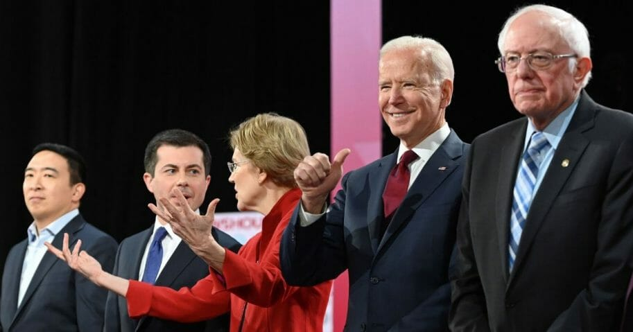 Democratic presidential hopefuls, from left, entrepreneur Andrew Yang; South Bend, Indiana, Mayor Pete Buttigieg; Massachusetts Sen. Elizabeth Warren; former Vice President Joe Biden; and Vermont Sen. Bernie Sanders stand on stage for a primary debate at Loyola Marymount University in Los Angeles on Dec. 19, 2019.