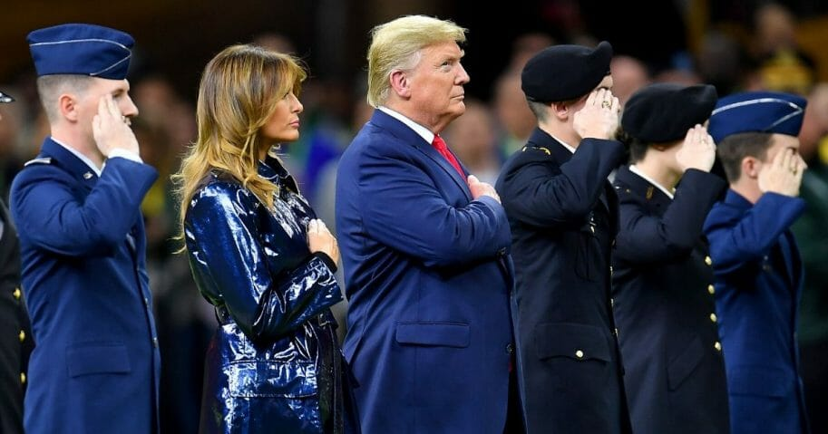 President Donald Trump and first lady Melania Trump took the field at the start of the College Football Playoff National Championship game between the LSU Tigers and the Clemson Tigers at the Mercedes Benz Superdome on Jan. 13, 2020, in New Orleans, Louisiana.