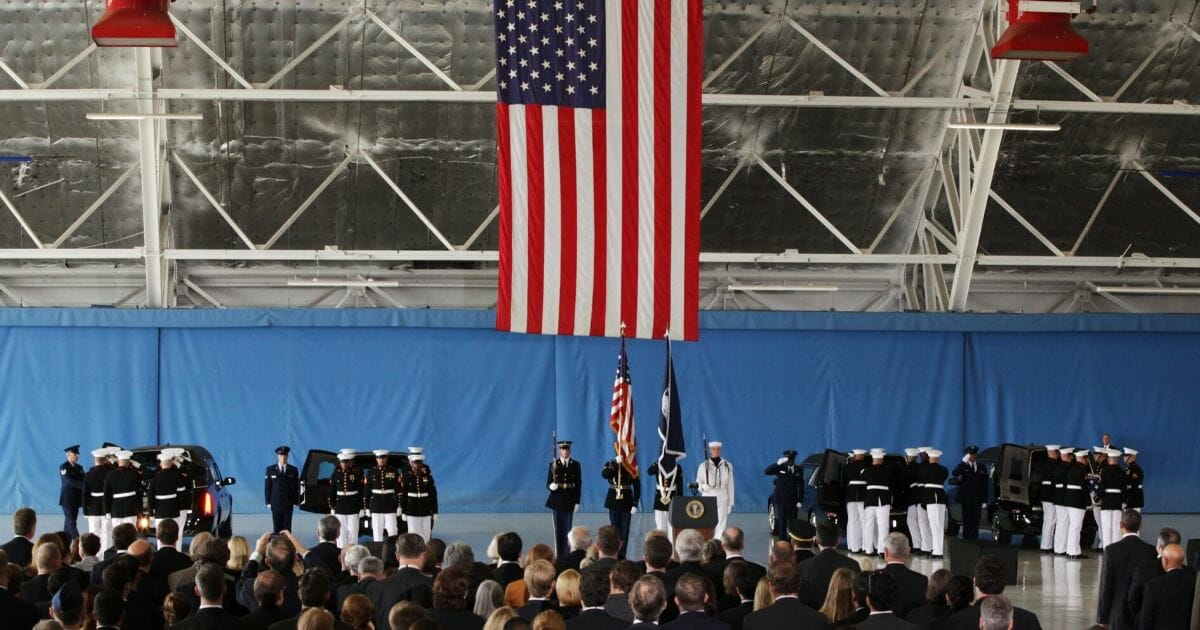 Caskets are placed into hearses Sept. 14, 2012, during the Transfer of Remains Ceremony for the four Americans killed in the attack on the U.S. Embassy in Benghazi, Libya.