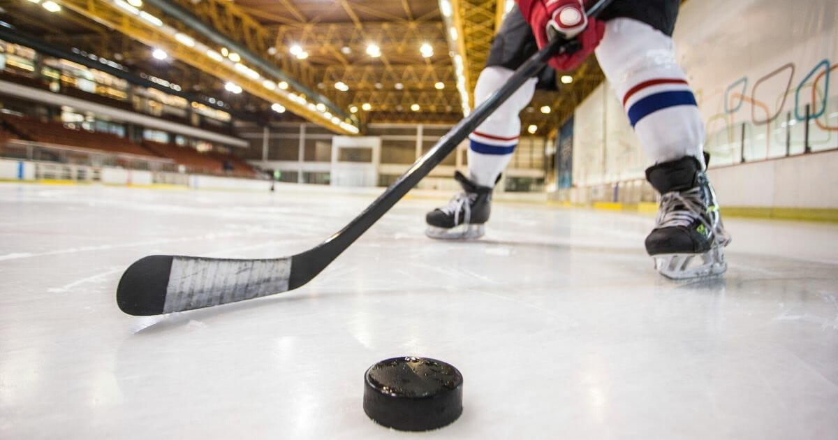 A stock image of a hockey player is seen above.