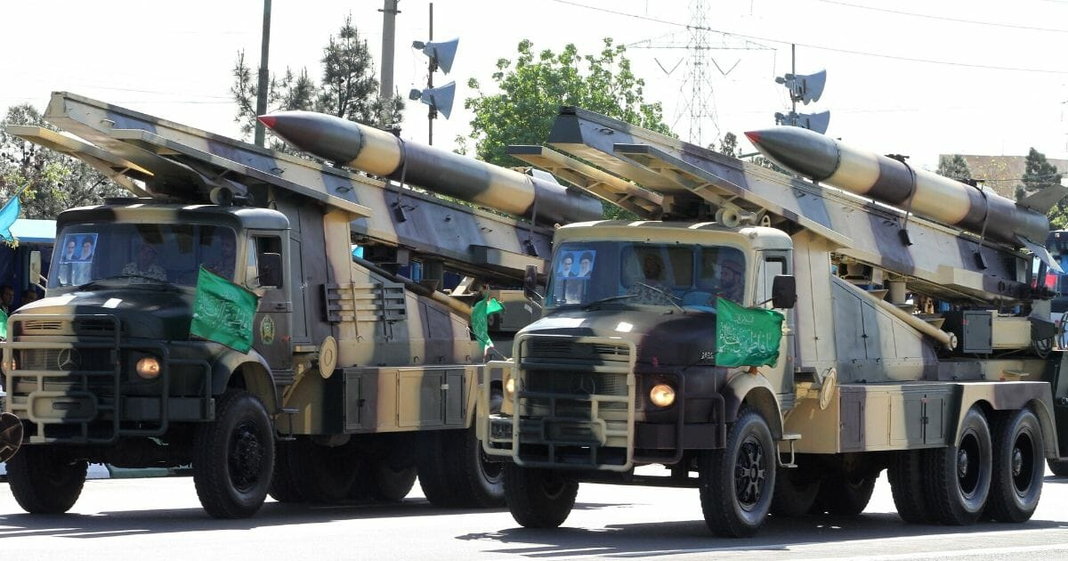 Iranian military trucks carry surface-to-air missiles during a parade on the occasion of the country's Army Day on April 18, 2017, in Tehran.