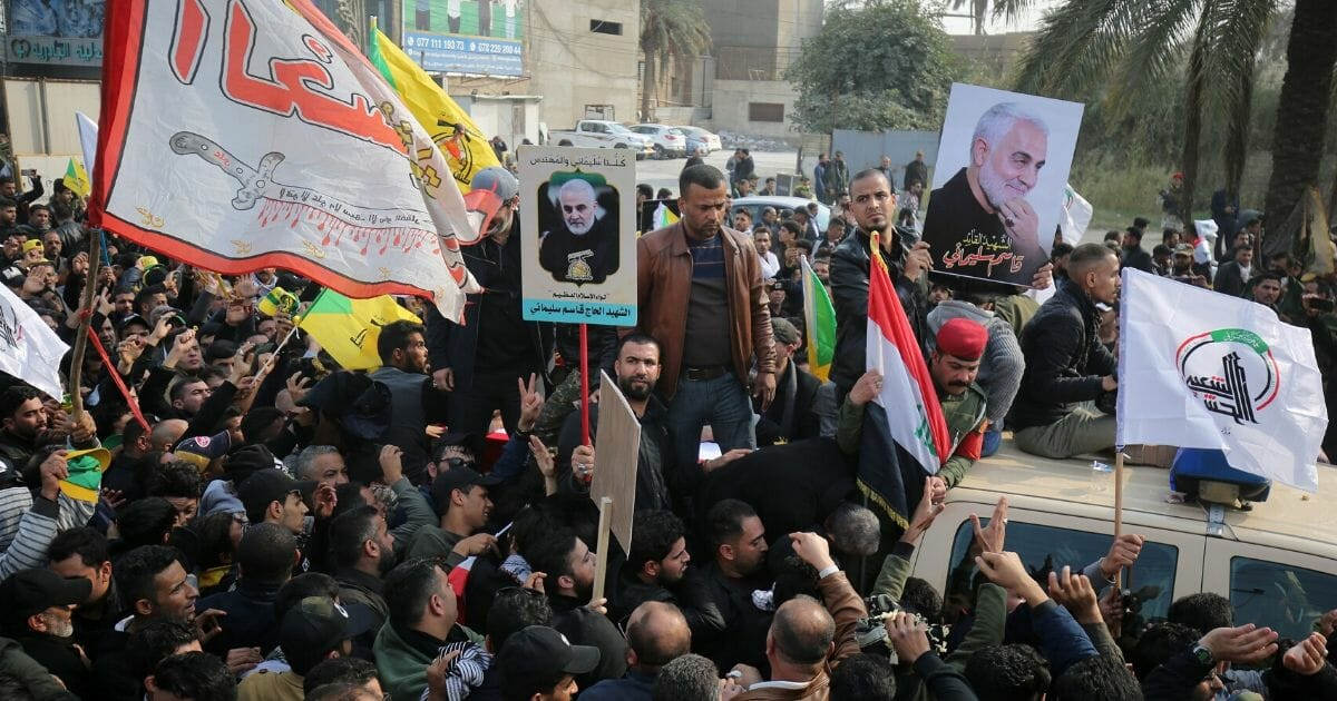 Supporters of the Hashed al-Shaabi paramilitary force attend the funeral procession of Iraqi paramilitary chief Abu Mahdi al-Muhandis, Iranian military commander Qassem Soleimani, and eight others in the capital Baghdad's district of al-Jadriya, near the high-security Green Zone, on Jan. 4, 2020.