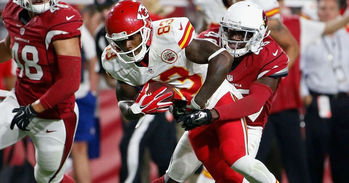 Wide receiver Fred Williams #83 of the Kansas City Chiefs is tackled by defensive back Jimmy Legree #46 of the Arizona Cardinals during the preseason NFL game at the University of Phoenix Stadium on Aug. 15, 2015, in Glendale, Arizona.