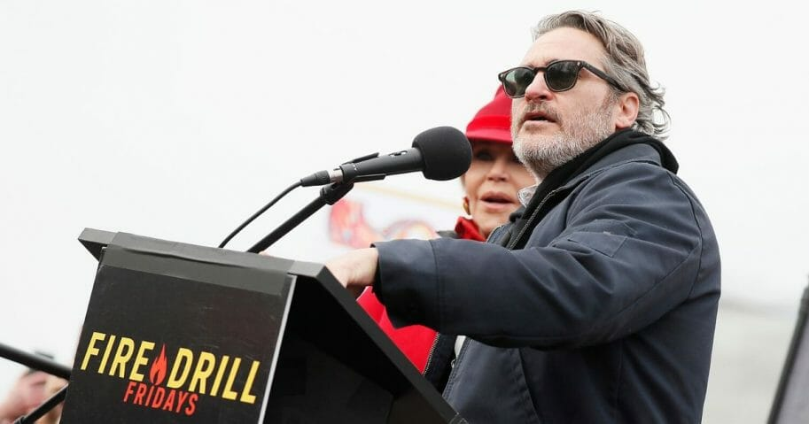 "Actor Joaquin Phoenix, right, onstage with actress and activist Jane Fond during the last ""Fire Drill Fridays"" climate change protest and rally on Capitol Hill on Jan. 10, 2020, in Washington, D.C."