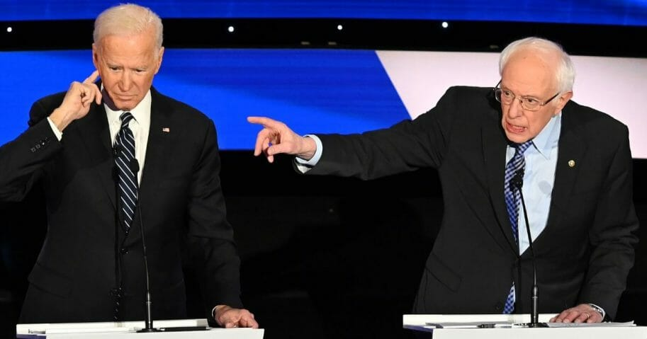 Former Vice President Joe Biden and Vermont Sen. Bernie Sanders square off during a Democratic presidential primary debate at the Drake University campus in Des Moines, Iowa, on Jan. 14, 2020.