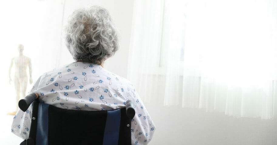 In the stock image above, an elderly woman sits in a wheelchair.