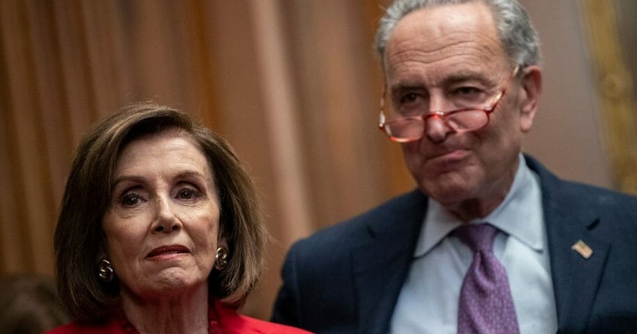 Speaker of the House Nancy Pelosi and Senate Minority Leader Chuck Schumer look on during a news conference at the U.S. Capitol in Washington on Nov. 12, 2019.