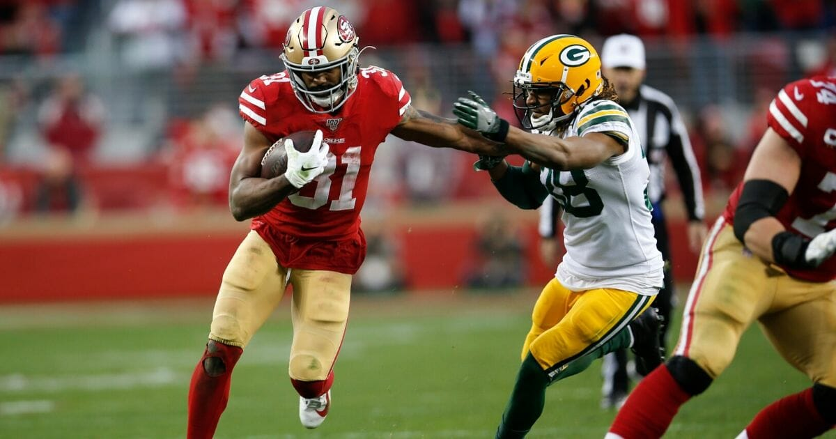 Raheem Mostert #31 of the San Francisco 49ers rushes during the game against the Green Bay Packers at Levi's Stadium on Jan. 19, 2020, in Santa Clara, California.
