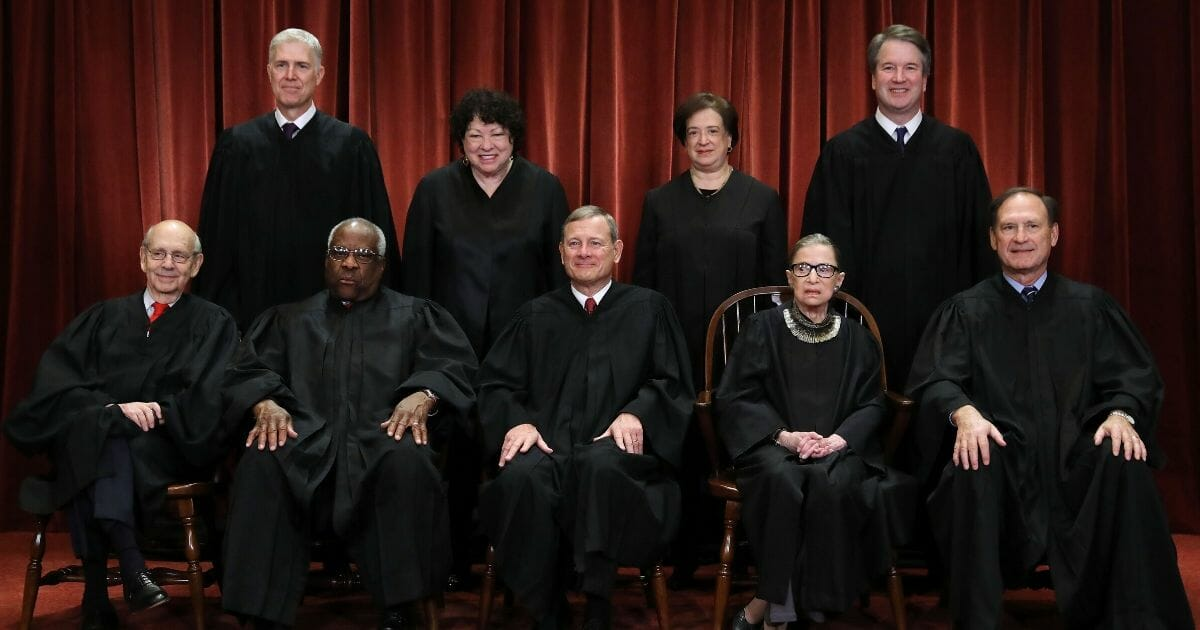 The nine Supreme Court justices pose for their official portrait in the East Conference Room at the Supreme Court building on Nov. 30, 2018, in Washington, D.C.