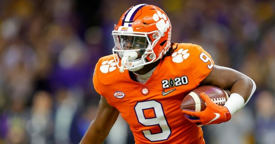 Travis Etienne of the Clemson Tigers runs the ball against LSU during the first quarter in the College Football Playoff championship game at the Mercedes Benz Superdome in New Orleans on Jan. 13, 2020.