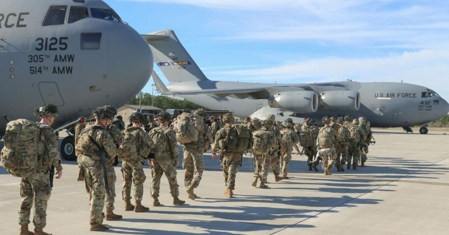 This handout picture released by the US Army shows U.S. Army paratroopers assigned to the 2nd Battalion, 504th Parachute Infantry Regiment, 1st Brigade Combat Team, 82nd Airborne Division, deploy from Pope Army Airfield, North Carolina, on Jan. 1, 2020.