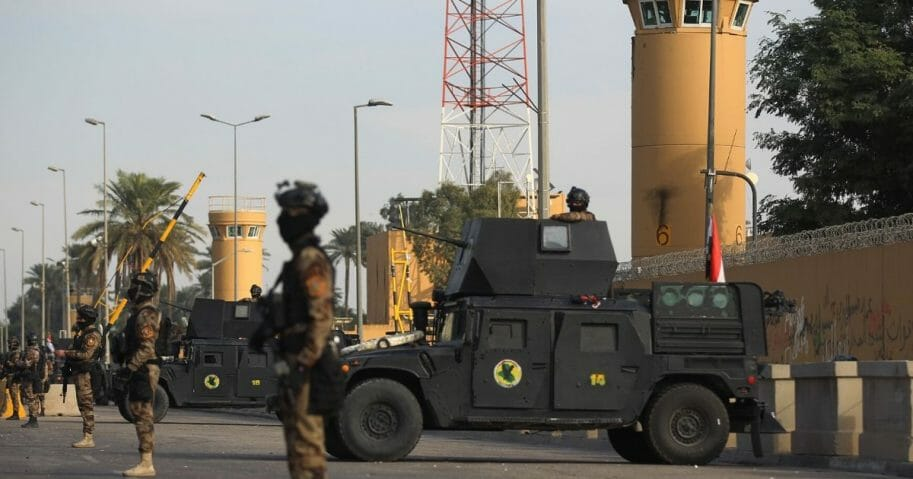 Iraqi counterterrorism forces stand guard in front of the U.S. Embassy in the capital city of Baghdad on Jan. 2, 2020.