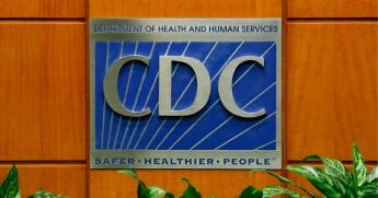 Centers for Disease Control logo seen on a podium.