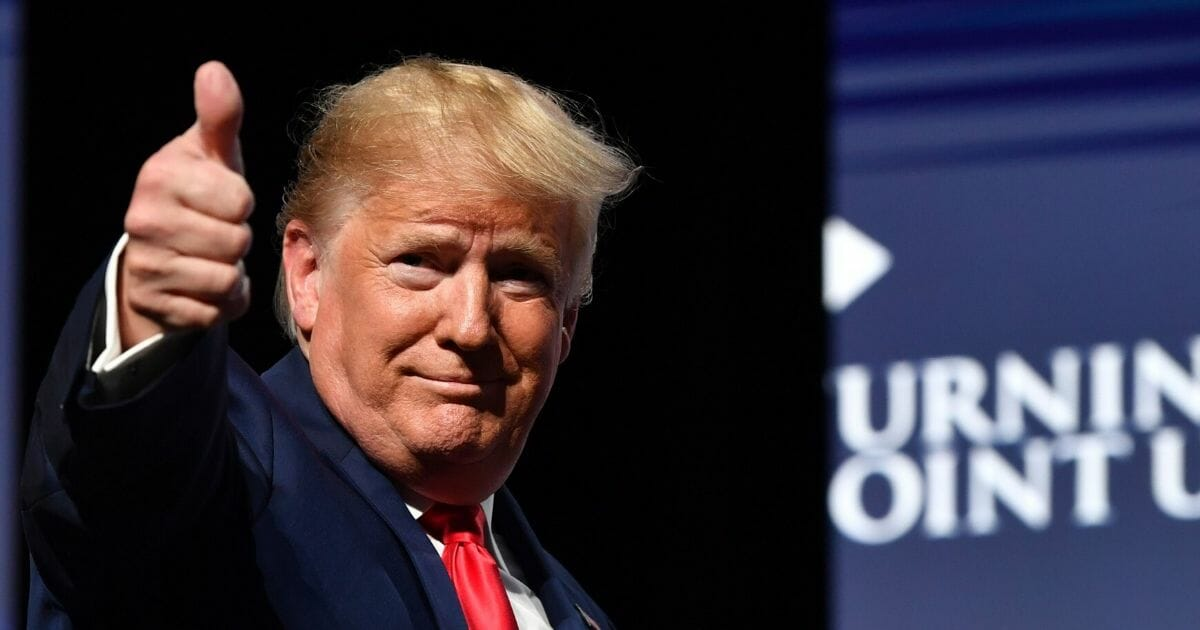 President Donald Trump gives a thumbs up to the crowd at the Turning Point USA Student Action Summit at the Palm Beach County Convention Center in West Palm Beach, Florida, on Dec. 21.