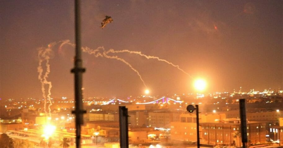 A handout picture received from the U.S. embassy in Iraq on Dec. 31, 2019, shows a U.S. Army Apache helicopter dropping flares over Baghdad's high-security Green Zone after Iraqi militants of pro-Iran factions breached the outer wall of the embassy.