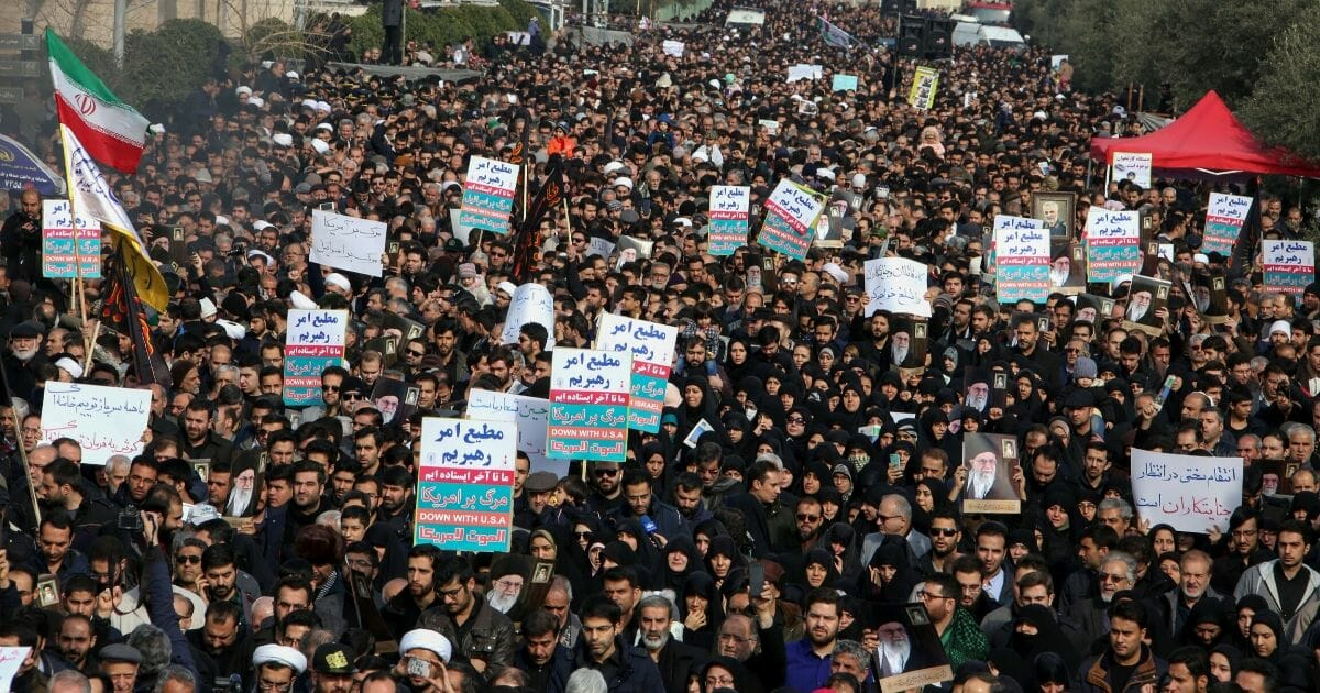 Iranians hold anti-U.S. banners during a demonstration in Tehran on Jan. 3, 2020, following the killing of Iranian Revolutionary Guards Major General Qassem Soleimani in a U.S. strike on his convoy in Baghdad.