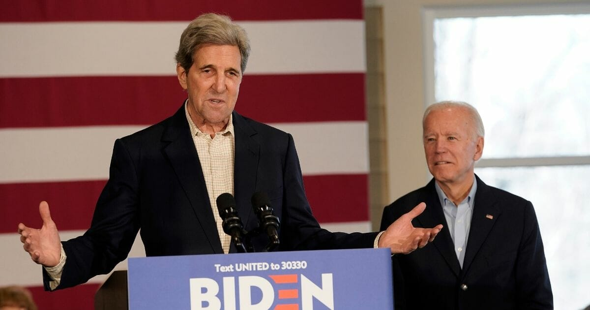 Former Secretary of State John Kerry at a podium endorsing former Vice President Joe Biden for the Democratic nomination in 2020.