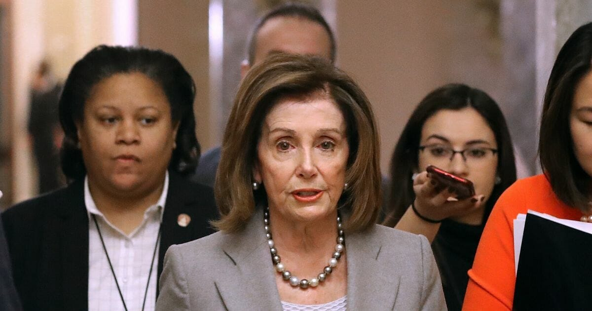 Speaker of the House Nancy Pelosi walks back to her office after leaving the House Chamber at the U.S. Capitol on Jan. 10, 2020, in Washington, D.C.