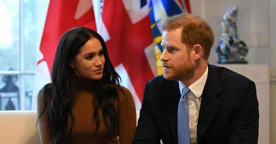 Britain's Prince Harry, Duke of Sussex, and Meghan, Duchess of Sussex, gesture during their visit to Canada House in London on Jan. 7, 2020.