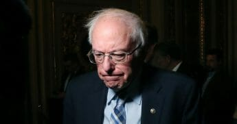 Vermont Sen. Bernie Sanders talks to reporters at the U.S. Capitol on Jan. 21, 2020, in Washington, D.C.