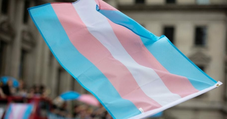 Stock image of a transgender flag being waved.