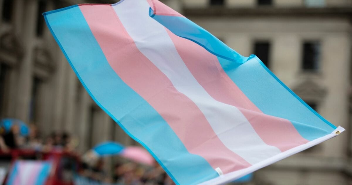 Stock image of a transgender flag being waved.
