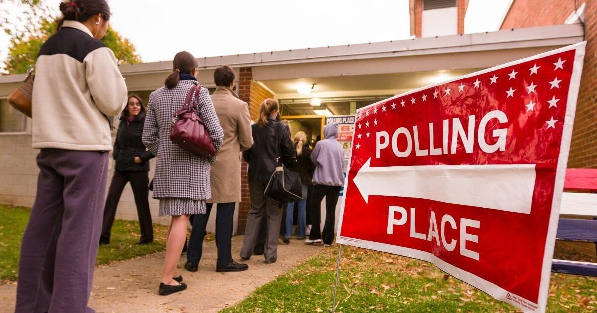 Stock image of people standing in line to vote in Arlington, Virginia.