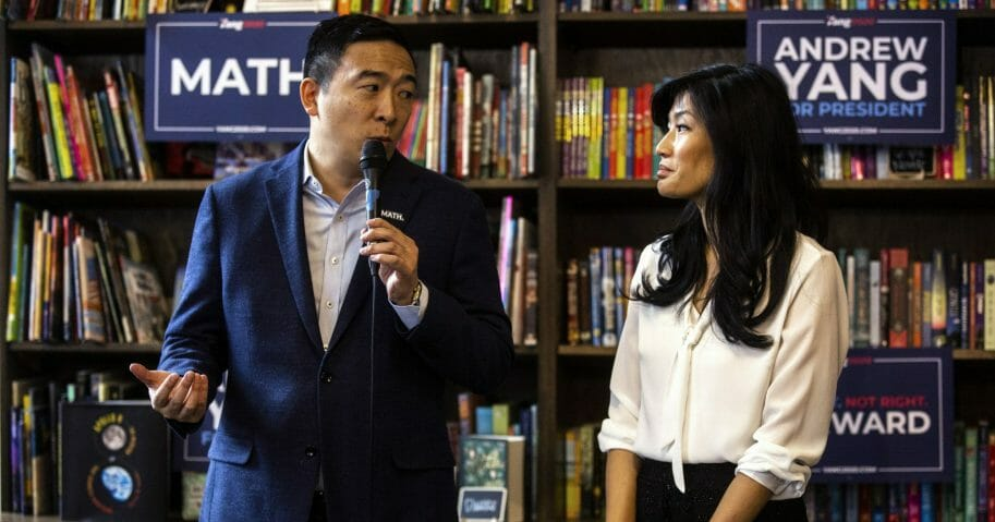 """Democratic presidential candidate businessman Andrew Yang and his wife, Evelyn, speak during the """"Family and Autism: An Honest Conversation"""" event at Sidekick Coffee & Books in Iowa City, Iowa, on Dec. 14, 2019."""