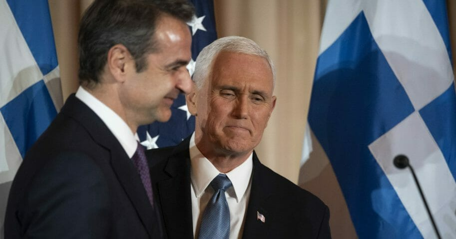 Vice President Mike Pence, right, and Greek Prime Minister Kyriakos Mitsotakis appear at a reception at the State Department in Washington on Jan. 8, 2020.