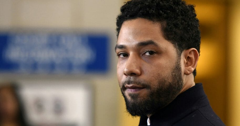 Actor Jussie Smollett talks to the media March 26, 2019, before leaving Cook County Court in Chicago.