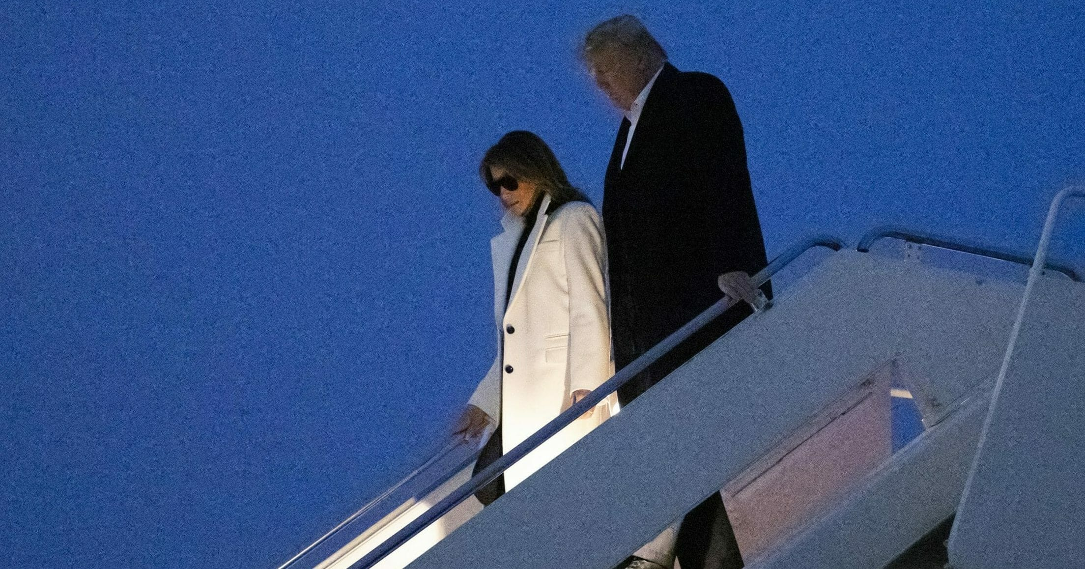 President Donald Trump and first lady Melania Trump step off Air Force One upon arrival at Andrews Air Force Base, Maryland, on Feb. 26, 2020, after a trip to India.