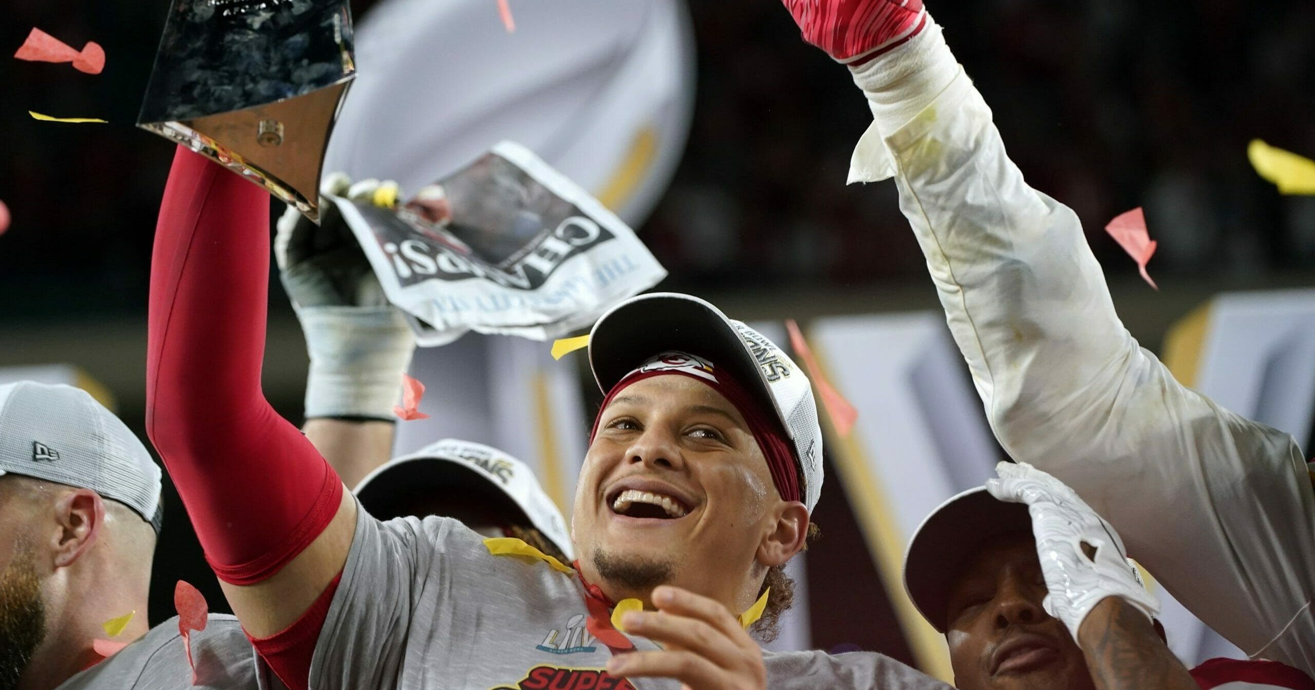Kansas City Chiefs quarterback Patrick Mahomes hoists the Lombardi Trophy after his team defeated the San Francisco 49ers in Super Bowl LIV on Feb. 2, 2020, in Miami Gardens, Florida.