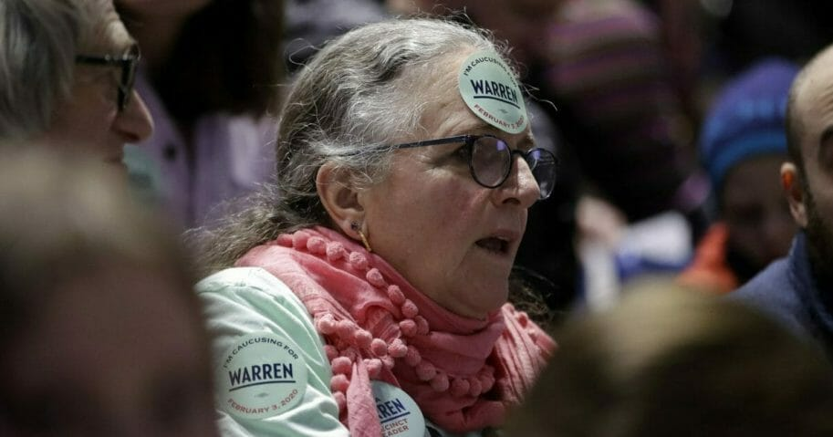 a woman caucusing for Sen. Elizabeth Warren in Iowa