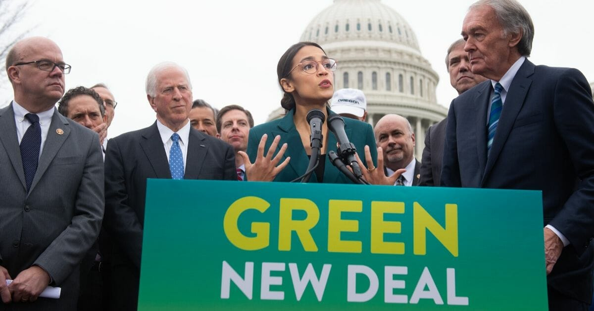 Rep. Alexandria Ocasio-Cortez of New York and other House Democrats speak during a news conference to announce their Green New Deal legislation Feb. 7, 2019, outside the U.S. Capitol in Washington.