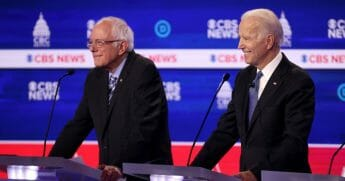 Vice President Joe Biden smiles as Sen. Bernie Sanders looks on